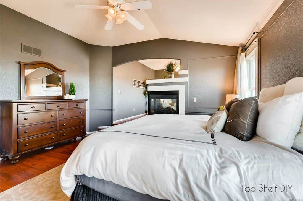 Charcoal master bedroom with picture frame molding