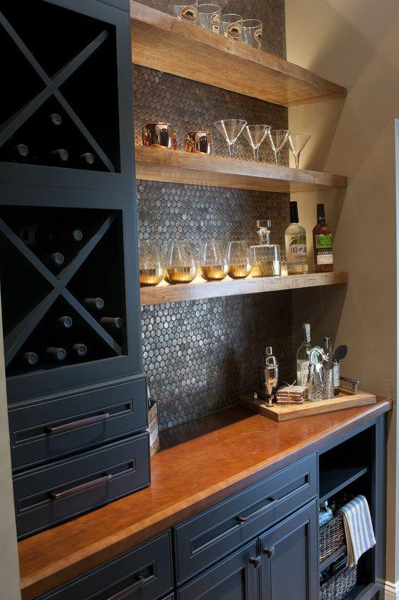 Dark bar with tile backsplash, floating shelves, X-shelf dividers