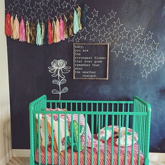 Chalkboard walls: one of 50 inexpensive ways to decorate a nursery on a budget. 50+ Ways to Decorate a Nursery on a Budget. Wall decor, lighting, paper crafts and so much more! Get all the tutorials and inspiration here.