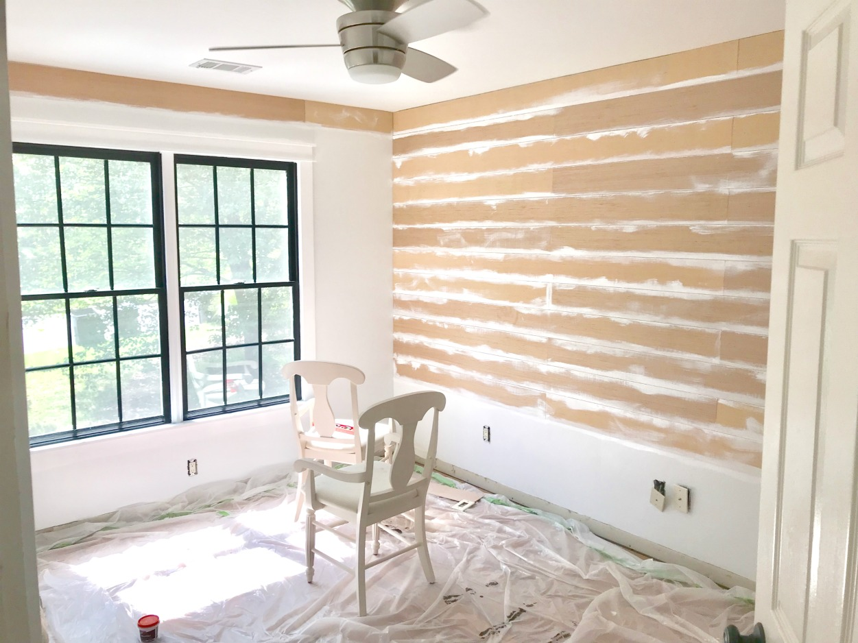 Shiplap Mistake #8 to avoid - painting between your boards as you go will prevent dark gaps later on! #diyhomeimprovement #shiplap