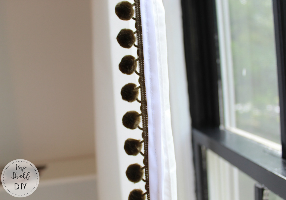 Give your standard ikea sheers a little boost by adding pom pom trim to the edge.