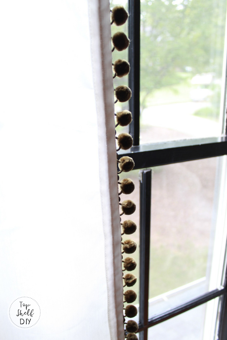 Get these adorable farmhouse curtains by adding pom pom trim to Ikea sheers! A $30 project. #ikeahack #farmhousecurtains