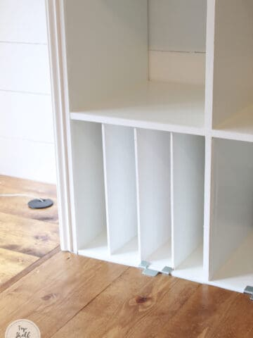 Add built-in organization with dividers made from plywood! Secured by small strips of wood inside. #ikeahack #kallax
