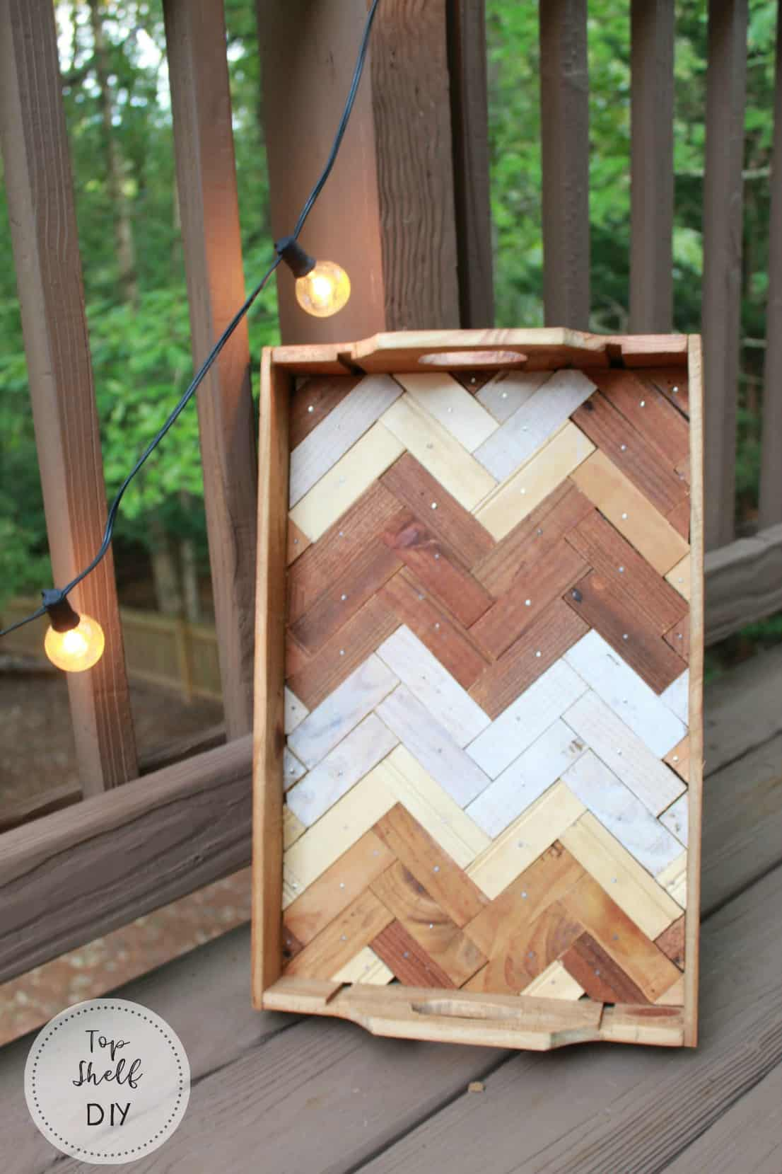 Make this herringbone tray from a repurposed wine crate! Get the full rundown here.
