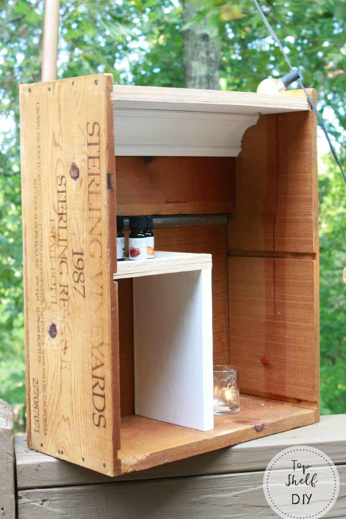 Make this shelf for essential oil storage from an old wine crate! Cheap, practical, and fun.