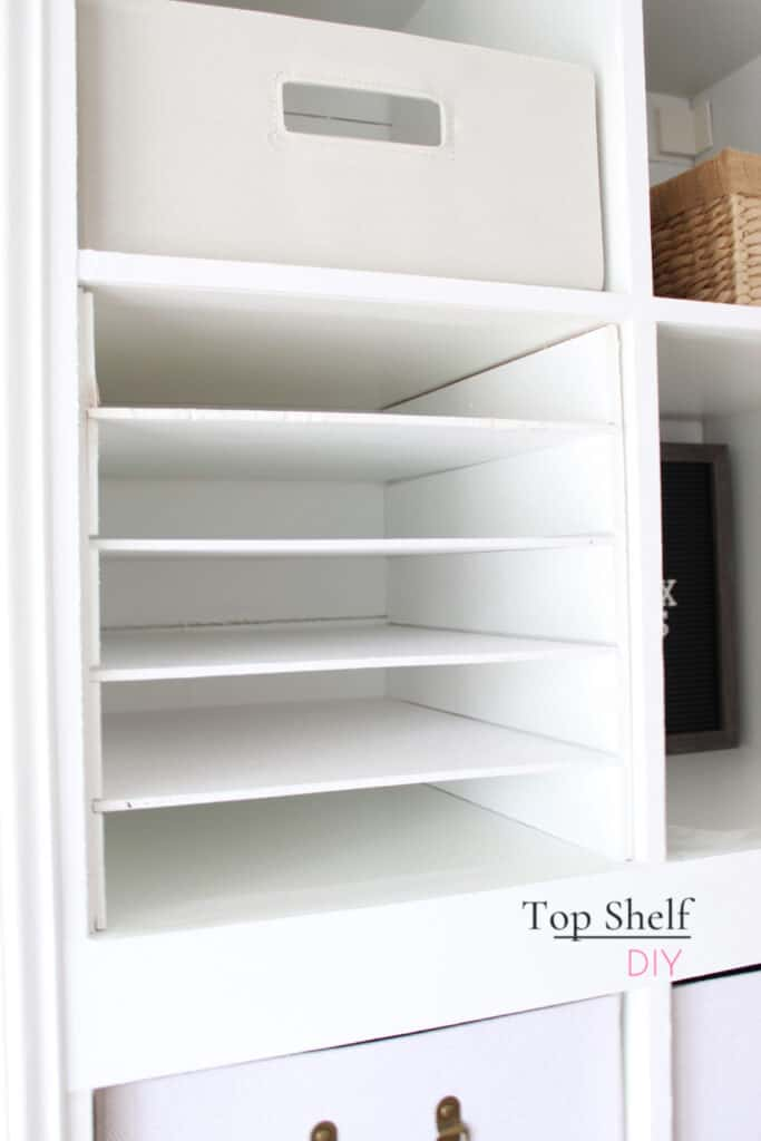Looking to organize your life in the new year? Check out this step-by-step tutorial for installing a custom, removable slot system for your Ikea Kallax. #kallaxhacks #kallax #ikeahack
