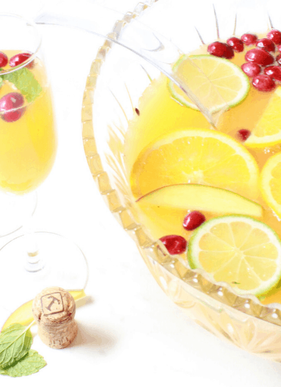 Make this simple recipe ahead of time for your upcoming NYE party! #nye #momcocktails #easychampagnepunch
