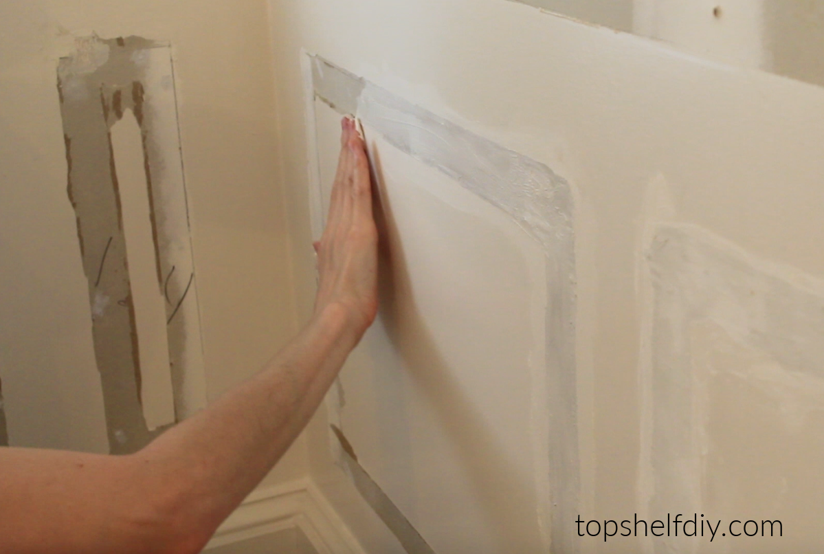 Patching your drywall when removing wainscoting.