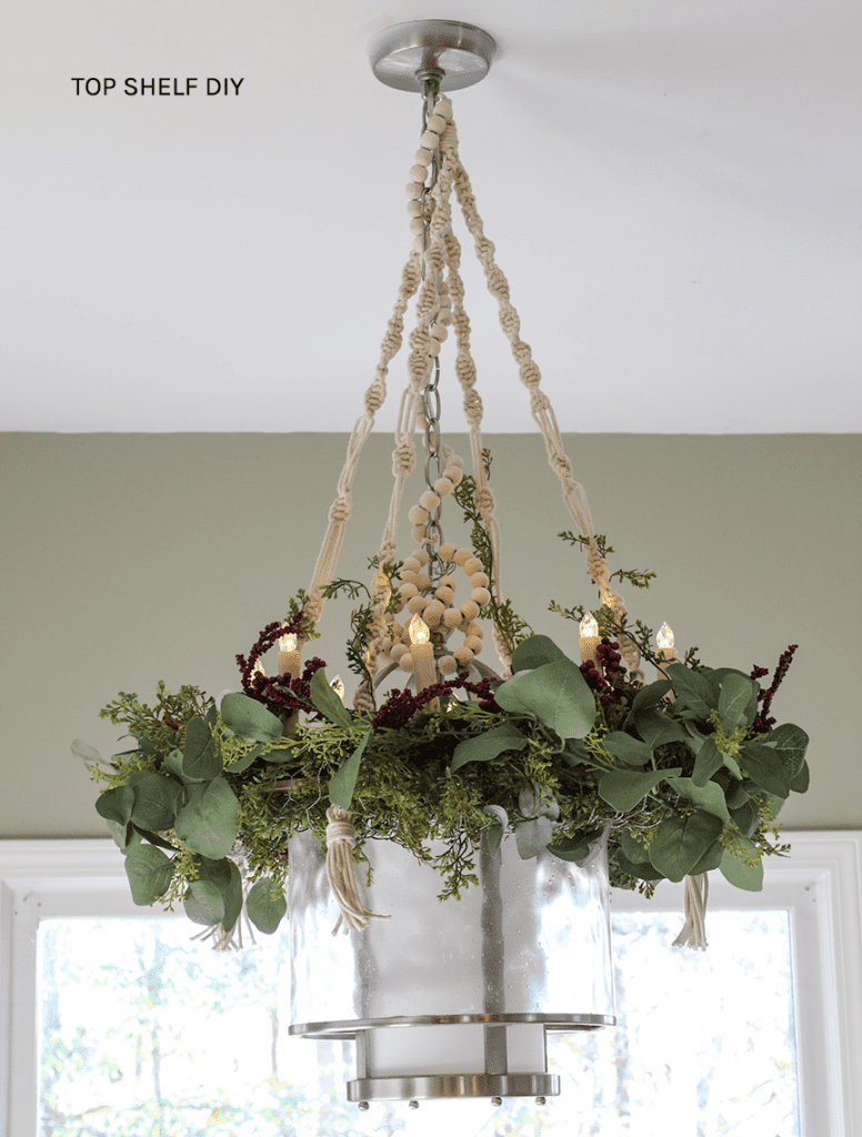 Christmas Craft Material Challenge Week 2: Macrame. Learn how to make this DIY Macrame Chandelier using very simple knots to transform your existing light fixtures. #holidaylighting #macramediy #macramechandelier